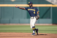 Michigan Wolverines second baseman Ako Thomas (4) makes a throw to first base against the Vanderbilt Commodores during Game 3 of the NCAA College World Series Finals on June 26, 2019 at TD Ameritrade Park in Omaha, Nebraska. Vanderbilt defeated Michigan 8-2 to win the National Championship. (Andrew Woolley/Four Seam Images)