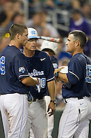 North Carolina outfielder Parks Jordan (8) talks with head coach Mike Fox (30) and assistant coach Scott Jackson (35) during Game 10 of the 2013 Men's College World Series against the North Carolina State Wolfpack on June 20, 2013 at TD Ameritrade Park in Omaha, Nebraska. The Tar Heels defeated the Wolfpack 7-0, eliminating North Carolina State from the tournament. (Andrew Woolley/Four Seam Images)