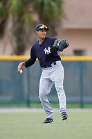 GCL Yankees East left fielder Alexander Santana (31) throws from the outfield during the first game of a doubleheader against the GCL Pirates on July 31, 2018 at Pirate City Complex in Bradenton, Florida.  GCL Yankees East defeated GCL Pirates 2-0.  (Mike Janes/Four Seam Images)