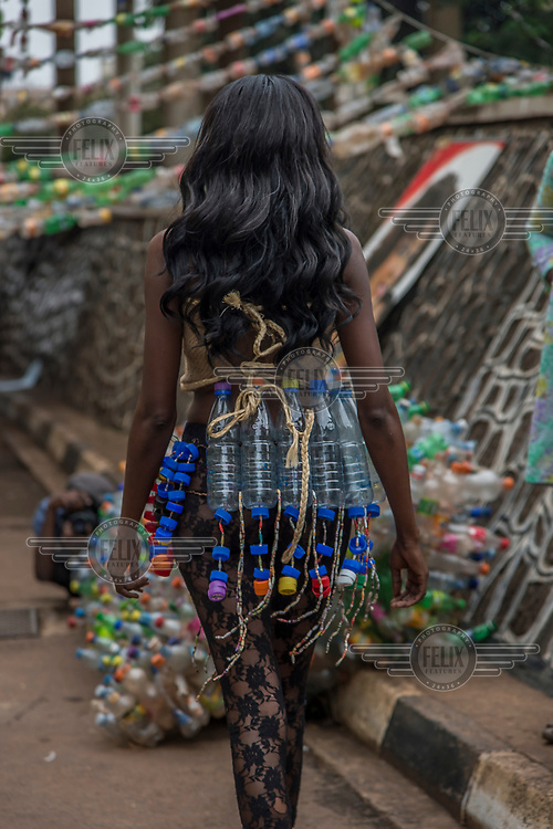 A model at the Trash on Fashion Show, part of the Bayimba cultural festival at the Kampala National Theatre, wearing clothes and jewellery made from waste plastic created by the Afrika Arts Kollective, which specialises in waste recovery and recycling. Their goal is to make the public aware of the possibilities of economy and ecology which conceal everyday life and its waste.