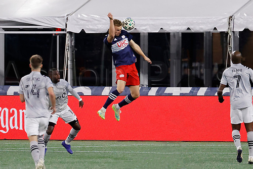 20th November 2020; Foxborough, MA, USA;  New England Revolution forward Adam Buksa heads the ball towards goal during the MLS Cup Play-In game between the New England Revolution and the Montreal Impact