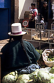 Cusco, Peru. Woman selling vegetables on the market.