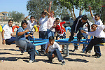 Children playing and having fun on the playground while mugging for the camera in San Felipe, Baja California