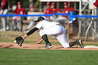 Jamestown Jammers third baseman Kevin Ross (23) stretches for a throw in the dirt during a game against the Mahoning Valley Scrappers on June 15, 2014 at Russell Diethrick Park in Jamestown, New York.  Jamestown defeated Mahoning Valley 9-4.  (Mike Janes/Four Seam Images)