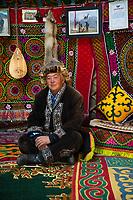 Mongolia, Bayan-Ulgii, Ulgii, Altai Mountains near Tsambagarav Mountain. Shaimurat, famous award winning eagle hunter at home in his yurt.