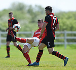 Brian Monaghan of Newmarket Celtic A in action against Eoghan Pewter of Bridge United A during their Clare Cup Final at Frank Healy Park. Photograph by John Kelly.
