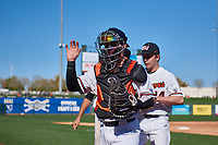 Oregon State Beavers catcher Troy Claunch (17) pretends to high five his teammates as he jogs off the field between innings of an NCAA game against the New Mexico Lobos at Surprise Stadium on February 14, 2020 in Surprise, Arizona. (Zachary Lucy / Four Seam Images)