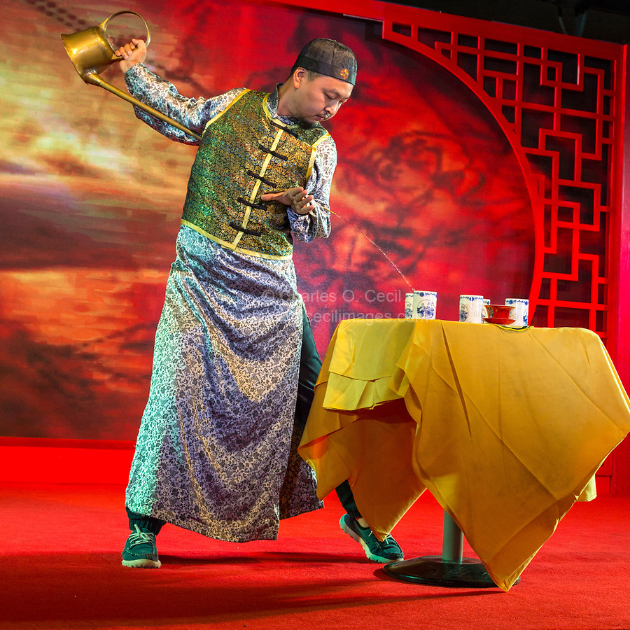 Wenzhou, Zhejiang, China.  Performer Demonstrating a Tea Pouring Ceremony.