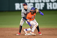 Stony Brook second baseman Brett Paulsen (14) wraps up Kier Meredith (1) of the Clemson Tigers, who was attempting a stolen base, as they await a call from the umpire in a game on Friday, February 21, 2020, at Doug Kingsmore Stadium in Clemson, South Carolina. After a video review, Meredith was called out. Clemson won, 2-0. (Tom Priddy/Four Seam Images)