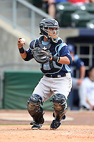 Corpus Christi Hooks catcher Rene Garcia (15) throws down to second in between innings during a game against the NW Arkansas Naturals on May 26, 2014 at Arvest Ballpark in Springdale, Arkansas.  NW Arkansas defeated Corpus Christi 5-3.  (Mike Janes/Four Seam Images)