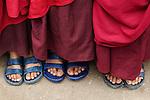 Feet of three child monks, Paro Valley, Bhutan