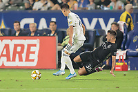 CARSON, CA - SEPTEMBER 15: Luis Martins #36 of Sporting Kansas City gets after Uriel Antuna #18 of the Los Angeles Galaxy during a game between Sporting Kansas City and Los Angeles Galaxy at Dignity Health Sports Complex on September 15, 2019 in Carson, California.