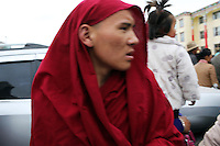 A Tibetan monk in a community on the Tibetan Plateau, in western China.