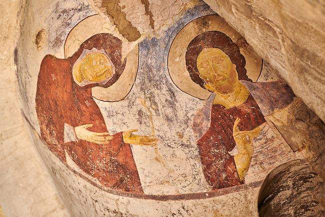 Picture & image of Vardzia medieval cave Church of the Dormition interior frescoes, part of the cave city and monastery of Vardzia, Erusheti Mountain, southern Georgia (country)<br /> <br /> Inhabited from the 5th century BC, the first identifiable phase of building took place at  Vardzia in the reign of Giorgi III (1156-1184) to be continued by his successor, Queen Tamar 1186, when the Church of the Dormition was carved out of the rock and decorated with frescoes