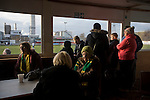 Runcorn Town 1 Runcorn Linnets 0, 26/12/2013. The Pavilions, North West Counties League Premier Division. Away supporters gathering in the tea room inside the ground before the Boxing Day derby match between Runcorn Town and visitors Runcorn Linnets at the Pavilions, Runcorn, in a top-of the table North West Counties League premier division match. Runcorn Linnets won 1-0 and overtook their neighbours at the top of the league in a game watched by 803 spectators. Runcorn Linnets were a successor club to Runcorn FC, one of England foremost non-League clubs of the 1970s and 1980s. Photo by Colin McPherson.