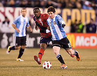 Maurice Edu (7) of the United States fights for the ball with Lionel Messi (10) of Argentina during an international friendly at New Meadowlands Stadium in East Rutherford, NJ.  The United States tied Argentina, 1-1.