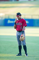 AZL Diamondbacks Eddie Hernandez (2) kisses the baseball before warming up in the outfield prior to the game against the AZL Cubs on August 11, 2017 at Sloan Park in Mesa, Arizona. AZL Cubs defeated the AZL Diamondbacks 7-3. (Zachary Lucy/Four Seam Images)