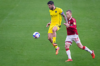 3rd October 2020; Riverside Stadium, Middlesbrough, Cleveland, England; English Football League Championship Football, Middlesbrough versus Barnsley; Alex Mowatt of Barnsley FC controls the high ball under pressure from Marc Bola of Middlesbrough FC