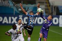 14th November 2020; Arena de Gremio, Porto Alegre, Brazil; Brazilian Serie A, Gremio versus Ceara; Goalkeeper Diego Souza of Gremio punches clear from Fernando Prass of Ceara