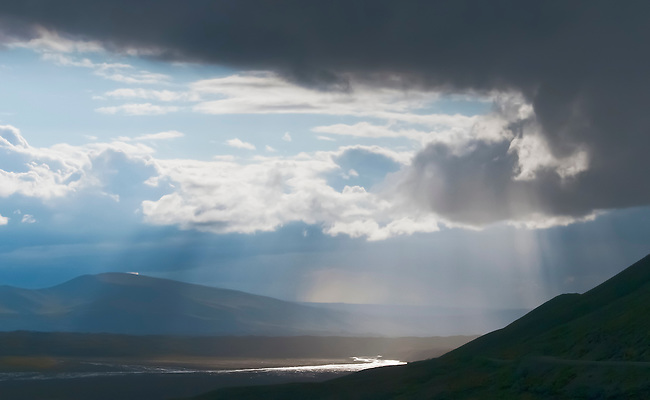 Storm clouds with virga over the McKinley River in Denali National Park, Alaska.