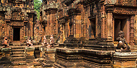 Ancient, beautiful 10th century Banteay Srei Shiva red sandstone temple and statues, in Angkor Wat Siem Reap complex, Cambodia Southeast Asia