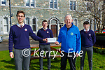 St Brendans College students present the funds from the Killarney Schools Christmas jumper appeal the the Killarney branch of Kerry Hospice at the school on Thursday l-r: Kacper Bogaleck, Tomas Clifford, Cathal Walsh and Mark Clifford