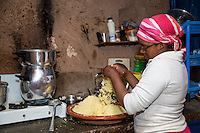 Morocco.  Woman Preparing Couscous in her Kitchen, Ait Benhaddou Ksar, a World Heritage Site.