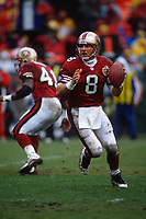 SAN FRANCISCO, CA:  Quarterback Steve Young of the San Francisco 49ers in action during the NFC playoff game against the Philadelphia Eagles at Candlestick Park in San Francisco, California on December 29, 1996. (Photo by Brad Mangin)