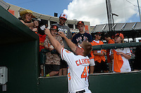 Baltimore Orioles catcher Steve Clevenger (45) signs autographs before a Spring Training game against the Tampa Bay Rays on March 14, 2015 at Ed Smith Stadium in Sarasota, Florida.  Tampa Bay defeated Baltimore 3-2.  (Mike Janes/Four Seam Images)