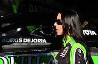 Feb. 10, 2012; Pomona, CA, USA; NHRA funny car driver Alexis DeJoria during qualifying at the Winternationals at Auto Club Raceway at Pomona. Mandatory Credit: Mark J. Rebilas-