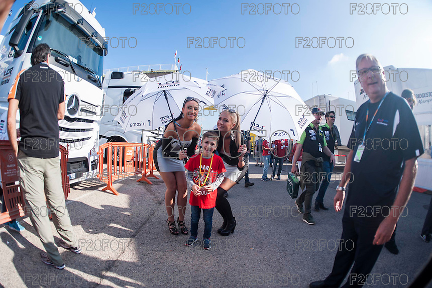 VALENCIA, SPAIN - NOVEMBER 8: Child shoot a photo with Rizoma paddok girls  during Valencia MotoGP 2015 at Ricardo Tormo Circuit on November 8, 2015 in Valencia, Spain