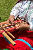 Peru, Urubamba Valley, Quechua Village of Misminay.  Woman Weaving Fabric.