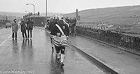 """The """"Nutters' Dance"""", Bacup, Lancashire  1973.  On Easter Saturday every year the """"Coco-nut"""" dancers gather at one boundary of the town and dance their way across to the other accompanied by members of the Stackstead Silver Band, collecting for charity as they go."""