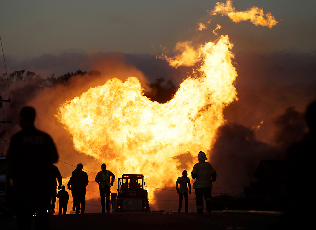 A massive fire is roars through a mostly residential neighborhood in San Bruno, Calif., Thursday, Sept. 9, 2010. Firefighters from San Bruno and surrounding cities are battling the blaze that started on a hillside and is now consuming homes in the residential neighborhood south of San Francisco. (AP Photo/Paul Sakuma)