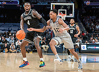 WASHINGTON, DC - FEBRUARY 19: Terrell Allen #12 of Georgetown moves in on Maliek White #4 of Providence during a game between Providence and Georgetown at Capital One Arena on February 19, 2020 in Washington, DC.