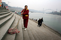 CHINA. Sichuan Province. Chongqing. A woman sweep stairs next to The Yangtze River which is at its lowest level in 150 years as a result of a country-wide drought. Chongqing is a city of over 3,000,000 people, famed for being the capital of China between 1938 and 1946 during World War II. It is situated on the banks of the Yangtze river, China's longest river and the third longest in the world. Originating in Tibet, the river flows for 3,964 miles (6,380km) through central China into the East China Sea at Shanghai.  2008