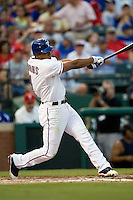 Texas Rangers shortstop Elvis Andrus #1 connects on his fourth inning double during the Major League Baseball game against the Texas Rangers at the Rangers Ballpark in Arlington, Texas on July 27, 2011. Minnesota defeated Texas 7-2.  (Andrew Woolley/Four Seam Images)