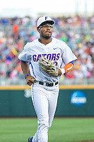 Buddy Reed (23) of the Florida Gators looks on during a game between the Miami Hurricanes and Florida Gators at TD Ameritrade Park on June 13, 2015 in Omaha, Nebraska. (Brace Hemmelgarn/Four Seam Images)