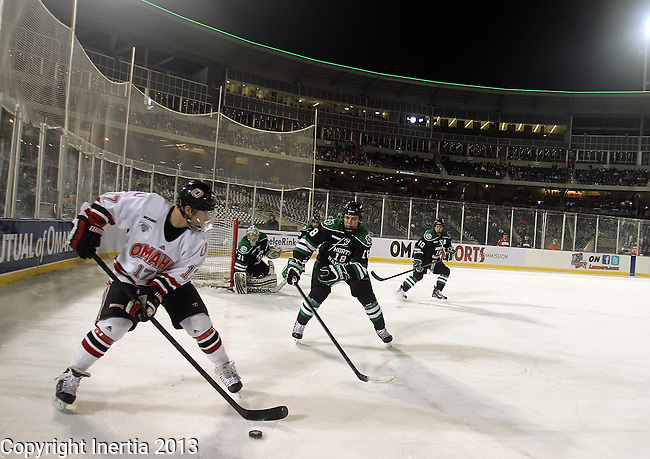 OMAHA, NE - FEBRUARY 9:  Ryan Walters #17 from the University of Nebraska Omaha looks for a teammate while being defended by Dillon Simpson #18 from the University of North Dakota in the second period at the Battle on Ice Saturday at TD Ameritrade in Omaha, NE. (Photo by Dave Eggen/Inertia)