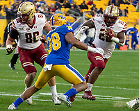 Boston College running back David Bailey (26) tries to elude Pitt linebacker Cam Bright (38). The Boston College Eagles defeated the Pitt Panthers 26-19 in the football game played at Heinz Field, Pittsburgh Pennsylvania on November 30, 2019.