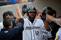 Akron RubberDucks Nellie Rodriguez (12) high fives teammates after hitting a home run during an Eastern League game against the Reading Fightin Phils on June 4, 2019 at Canal Park in Akron, Ohio.  Akron defeated Reading 8-5.  (Mike Janes/Four Seam Images)
