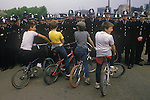 Miners Strike. Orgreave Near Rotherham Yorkshire 1984. Children on their chopper bikes and the police line. 1980s UK