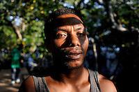 A Seramese manual labourer in mangrove swamp near the sleepy capital of Seram Island, Masohi. /Felix Features