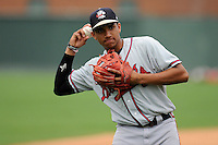 Photo of the Rome Braves warms up before a game against the Greenville Drive on Thursday, July 31, 2014, at Fluor Field at the West End in Greenville, South Carolina. (Tom Priddy/Four Seam Images)