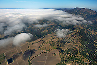 aerial photograph of vineyards at the base of Mount St. Helena, Calistoga, California, on the right Highway 29 serpentines along Mount St. Helena toward Middletown in Lake County
