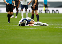 28th August 2020; Tottenham Hotspur Stadium, London, England; Pre-season football friendly; Tottenham Hotspur v Reading FC;  Son Heung-Min of Tottenham Hotspur laying on the pitch injured after taking a knock from Liam Moore of Reading