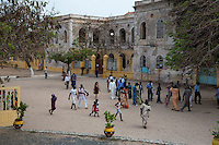 Visitors at the Biannual Arts Festival (Regards sur Cours) Walk past the Abandoned Residence of the Former French Colonial Governor, Goree Island, Senegal.