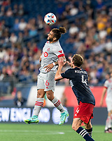 FOXBOROUGH, MA - JULY 7: Dom Dyer #6 of Toronto FC heads the ball during a game between Toronto FC and New England Revolution at Gillette Stadium on July 7, 2021 in Foxborough, Massachusetts.