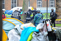 Officials try to clear protesters from the site during a protest against the building of the HS2 railway line at Euston Square Gardens on 27th January 2021