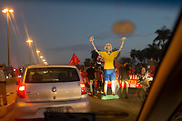 A small protest holds up cars heading to the airport in Rio De Janiero